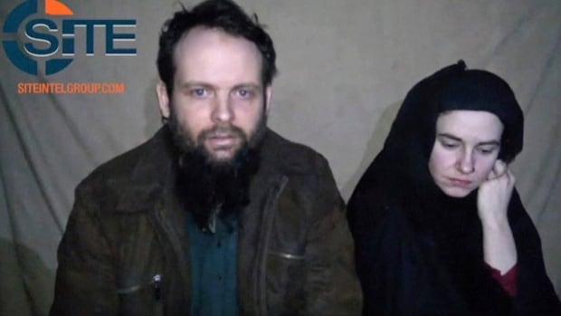 This undated militant file image from video posted online in August 2016 provided by SITE Intel Group shows Canadian Joshua Boyle and American Caitlan Coleman who were kidnapped in Afghanistan in 2012. Another video was released on Dec. 19 that appear