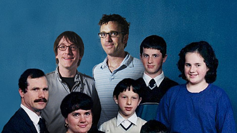 Artists Gordon Winiemko (left) and Jeff Foye (right) in the back, have Photoshopped themselves into a classic family portrait.