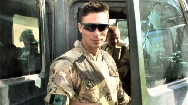 Retired master corporal Collin Fitzgerald, seen in Afghanistan in 2006, says he's facing a mountain of debt after facing criminal charges that were stayed. 'Why should I be in financial disarray for the next 30 years trying to pay back what I owe, that I had to borrow to get my freedom?'