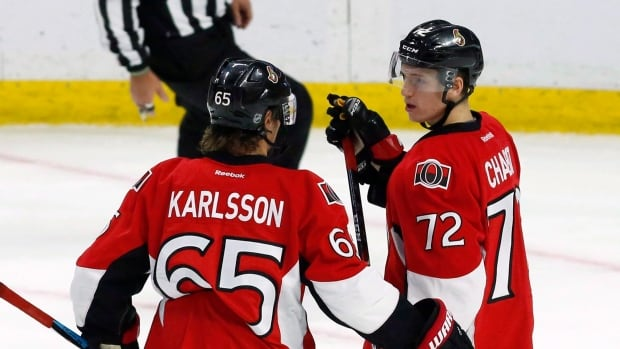 Thomas Chabot, right, is hoping a successful world junior tournament will cement him a spot beside Erik Karlsson and the Ottawa Senators next year.