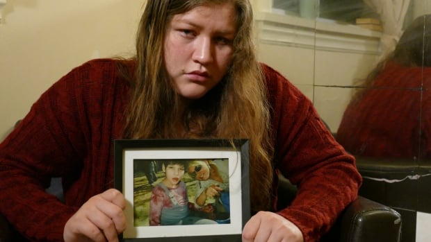 Jessica Whitford holds a picture of her sister, Lydia. She is searching for answers after Manitoba RCMP said her sister's death was a homicide.