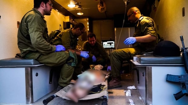 Israeli army medics tend to an injured Syrian in the occupied Golan Heights.