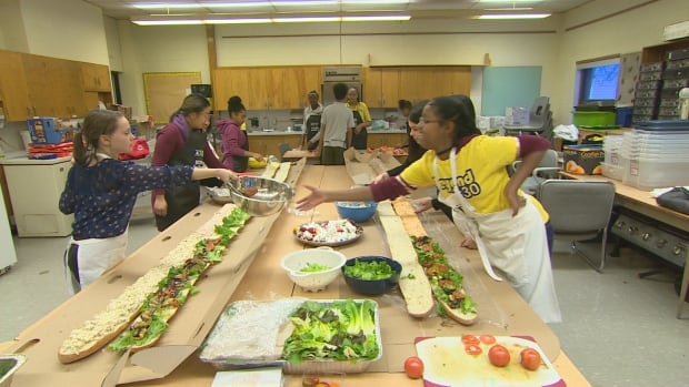 Students learn to make healthy meals in the after-school program.