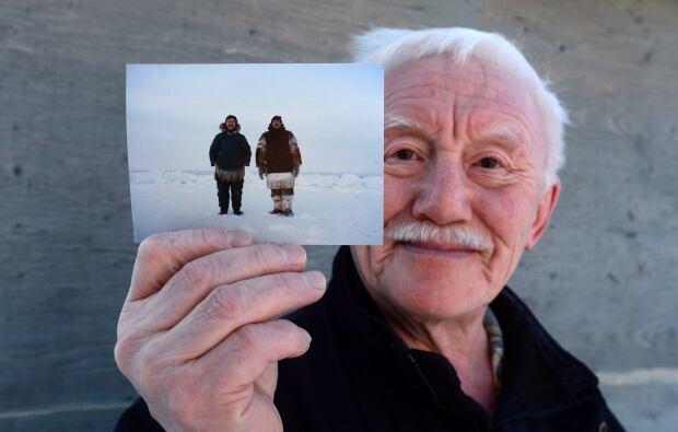 Piita Irniq holds photograph of Marius Tungilik