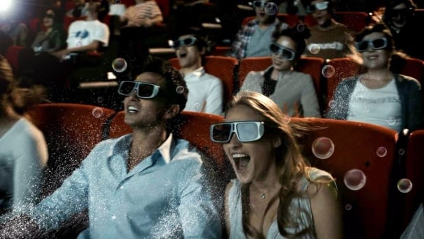 People watch a film in 4DX technology at a Cineplex theatre.