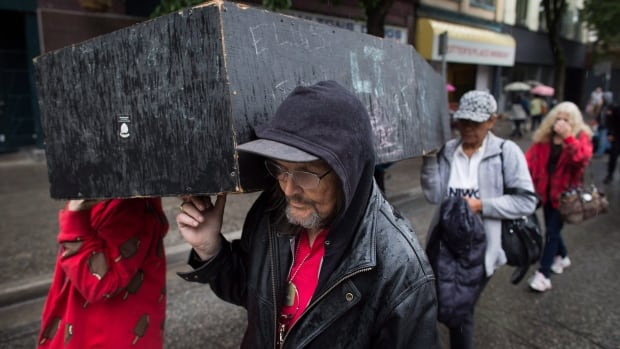 Marchers carried a coffin to remember friends, family and community members during a procession to mark Overdose Awareness Day in Vancouver in August.  The highly potent opioid fentanyl was detected in more than 370 drug overdose deaths in British Columbia between January and October 2016.