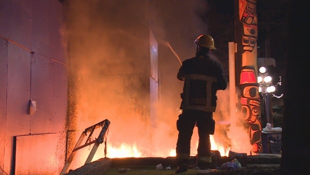 Vancouver firefighters battle flames at a homeless area in Pigeon Park early Thursday morning. Officials say the cold weather has heightened fears of fire hazards in homeless camps
