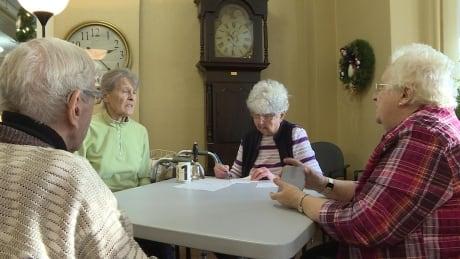 Seniors at Wales Home playing cards