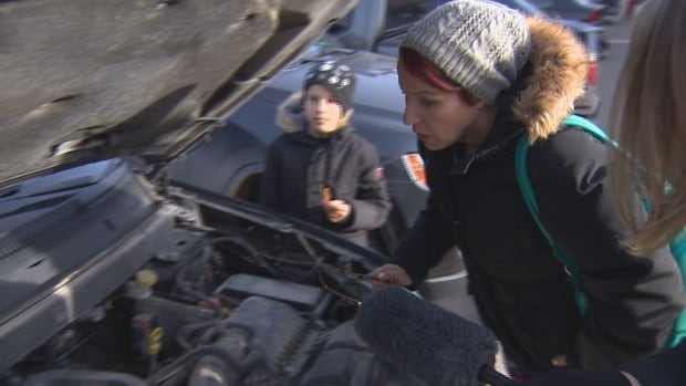 Crystal Taillefer looks under her hood after the I-Team told her about a recall on her car. The team's investigation found one in six cars in Canada are part of an open recall.