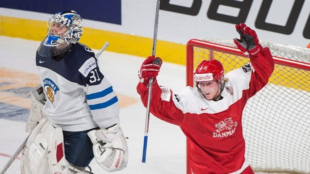 Frederik Hoeg (22) celebrates during Denmark's 3-2 win over Finland at the World Juniors on Tuesday, in Montreal.