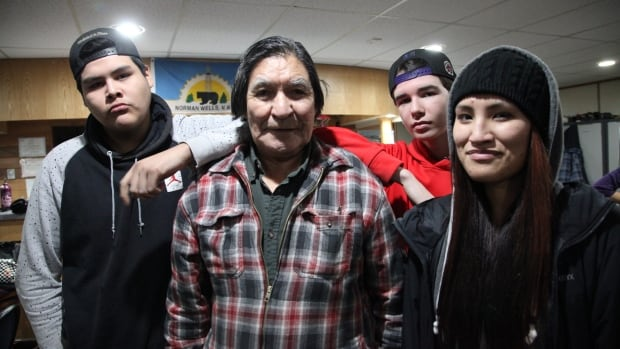 A group of youth in Norman Wells pose with Edward Oudzi, the subject of their film. (Left to right) Julian Behrens, Edward Oudzi, Mckenzie Barney, Teyanna Kakfwi.