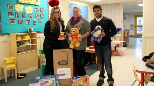 YNOTFORTOTS founders, Mohit Sodhi and Lindsay Richter at Our House Child Care Centre with daycare supervisor, Kelly Bodkin.