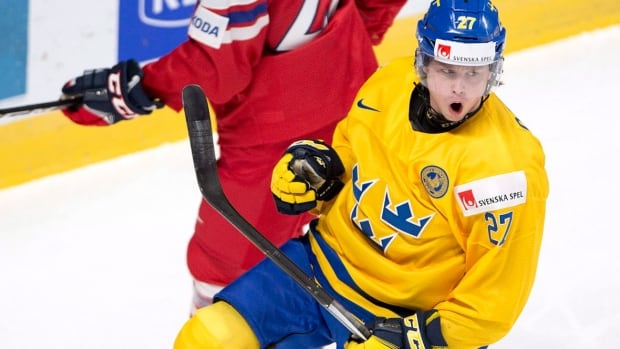 Sweden's Jonathan Dahlen celebrates after scoring during a 5-2 win ...