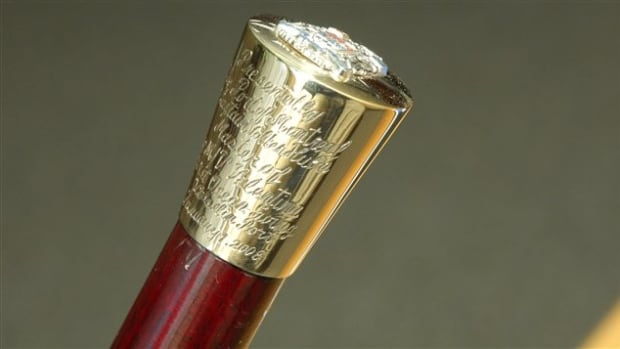 The gold-headed cane presentation is a tradition at the Port of Montreal that dates to 1840.