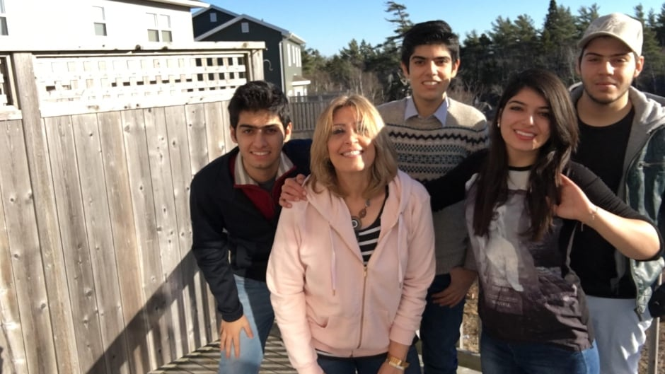 Syrian refugees Lina Arafeh and her kids live in Halifax but plans to move to a bigger city hoping to find work.