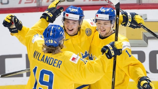 Sweden's, from left, Alexander Nylander, Jonathan Dahlen and Carl Grundstrom have helped their team win all five of its games at this year's world juniors.