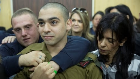 Israeli soldier who shot prone Palestinian assailant sentenced to 18 months