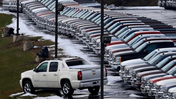 Chevy trucks line the lot of a dealer in Murrysville, Pa. Demand may be slowing, but U.S. consumers still bought a whole lot of cars and trucks in 2016. U.S. sales of new vehicles could hit a new high in 2016.