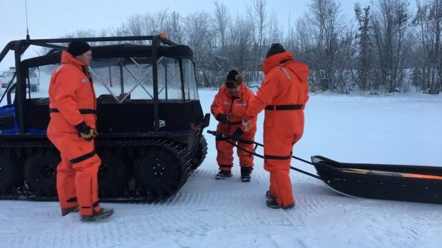 Workers were out testing ice thickness Wednesday on Yellowknife Bay, in anticipation of the start of construction of the Dettah ice road. Construction is slated to begin Thursday.