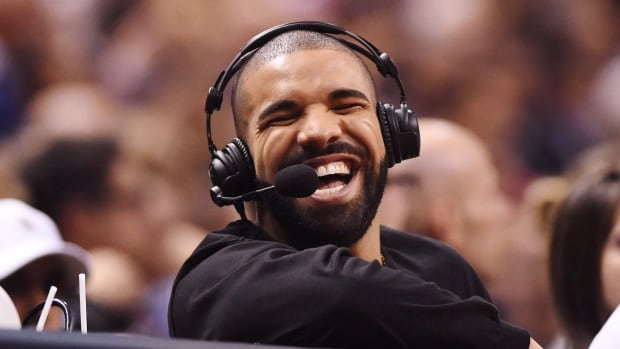 Rapper Drake helped music streaming services explode in 2016. Here, he has a laugh during an NBA game between the Golden State Warriors and Toronto Raptors in Toronto on Wednesday, November 16, 2016.