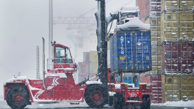 A container is unloaded from a truck at Montreal's Port, Wednesday, January 4, 2017.