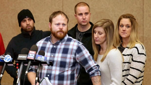 Family spokesman David Boyd and others hold a news conference Thursday in Crystal Lake, Ill., after an 18-year-old man was assaulted in Chicago earlier this week.