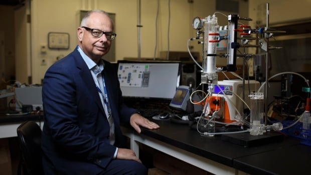 Carlo Montemagno is pictured with a foam bioreactor for carbon capture in Edmonton. His technology harnesses photosynthesis, the process plants use to convert carbon dioxide into chemical energy using light.