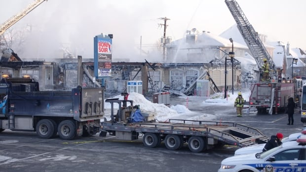 The Laval police arson squad is investigating a fire that gutted a commercial building in the Vimont neighbourhood early Monday morning.
