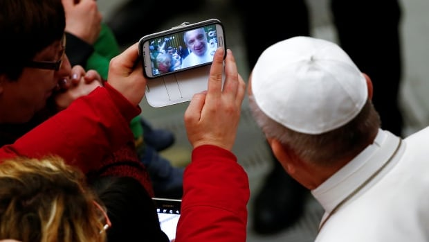 Pope Francis poses for a selfie at the Vatican on Jan. 5, 2017.