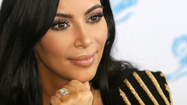French authorities have filed the first charges against three suspects in the armed jewelry heist of Kim Kardashian, with more charges expected to follow, the Paris prosecutors' office said Thursday.