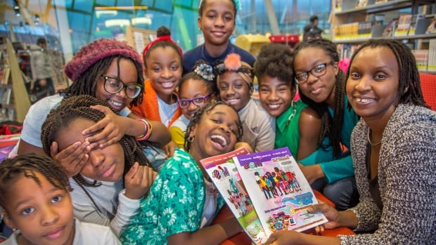 Annette Bazira-Okafor (far right) with the young writers of Black Girls Magazine.