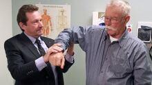 Orthopedic surgeon Dr. Robert Balyk with patient Douglas Gilroyed