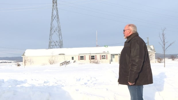 Mayor Normand Pelletier looks at at the Bay of Chaleur, past the old Dalhousie Marina, which is scheduled to be demolished later this year.