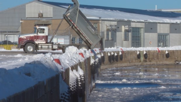 A CBC News camera captured video of snow being dumped into the harbour Monday.