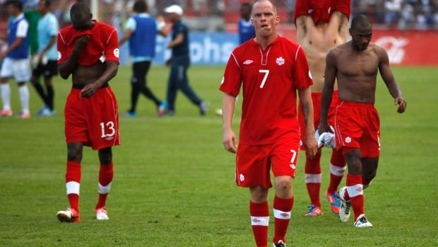 Ian Hume (7) and the rest of Canada's men's national team exit the field in 2012 after failing to qualify for the 2014 World Cup.