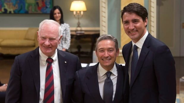 François-Philippe Champagne poses between Governor General David Johnston and Prime Minister Justin Trudeau during Tuesday's cabinet shuffle at Rideau Hall in Ottawa.