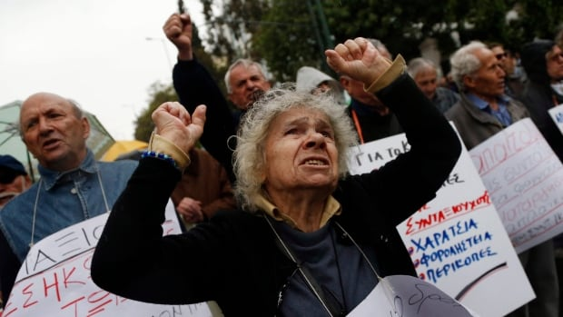 Pensioners protest deep income cuts in central Athens in this April 2013 photo. A report from the World Economic Forum says income and wealth disparity could be a major driver of global events over the next 10 years.