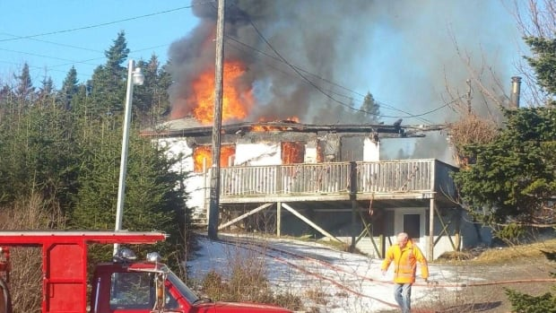 Firefighters were battling flames when police arrived on the scene about 11 a.m. Wednesday.