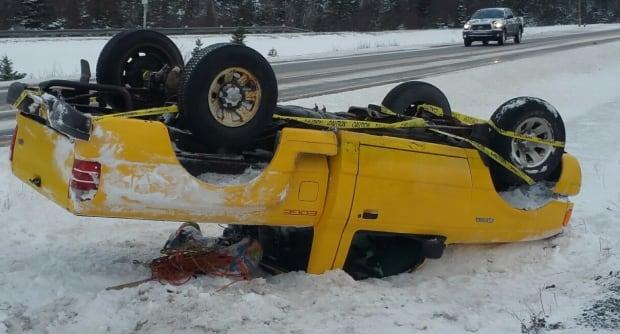 Yellow pickup truck flipped THC holyrood