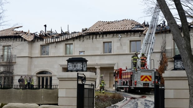 Firefighters had the fire under control as daylight broke, but continued to work at the mansion on Wednesday.