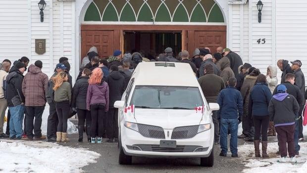 Family and friends arrive at the funeral for Brenda Desmond and her son Lionel Desmond at St. Peter's Church in Tracadie.