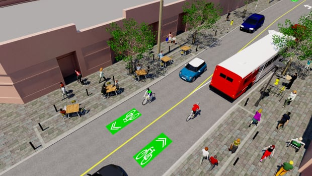 Vehicles and cyclists would share the road, because there wouldn't be enough room to accommodate a segregated bike lane. The speed limit would be reduced to 30 km/h.