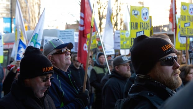 Between 100 and 200 maritime workers gathered outside Liberal MP Hedy Fry's office in Vancouver to protest the Canada-EU trade agreement, citing fears of lost jobs and lowered safety standards on B.C. coasts.