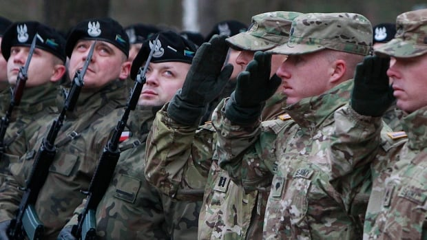 U.S. soldiers are welcomed in Zagan, Poland, on Thursday, as part of a deterrence force of some 1,000 troops.