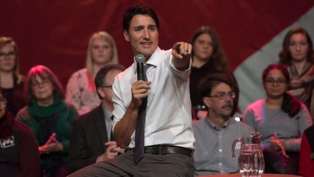 Prime Minister Justin Trudeau points to a member of the audience during a town hall meeting in Belleville, Ont. on Thursday.