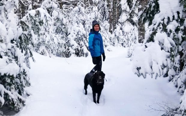 Sue Norton hikes in winter at the Brookvale woodlot with Otis the lab