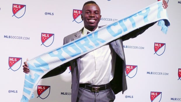 Canadian Kwame Awuah, a University of Connecticut midfielder, poses after being selected 16th overall by the New York City FC at the MLS SuperDraft in Los Angeles on Friday.