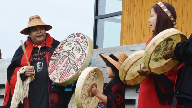 Traditional garb is worn by performers at the opening of a new health centre for the Metlakatla First Nation.
