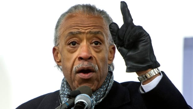 'We're here because we fought hard to make sure that this administration heard our cry, and we are not going away now,' the Rev. Al Sharpton told the civil rights rally.
