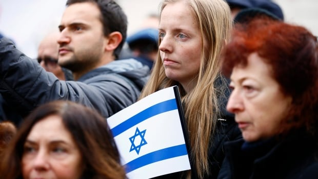 Pro-Israel demonstrators listen to speeches during a gathering in front of Israel embassy in Paris, France, on Sunday.